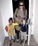 Angelina Jolie leaves LAX Airport with daughters Zahara and Shiloh