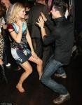 Rosamund Pike dancing with actor Dominic Cooper