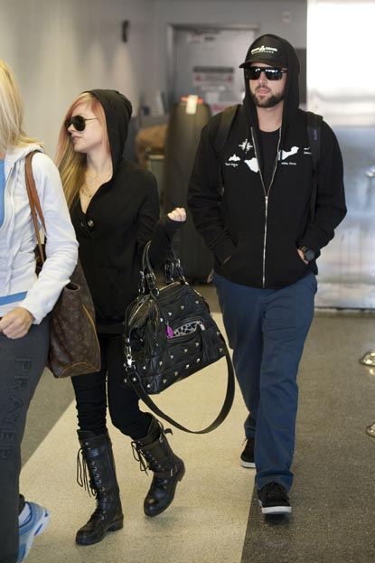 Avril Lavigne and Brody Jenner depart LAX